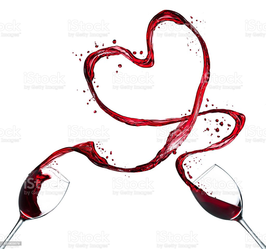 Red wine splash heart on white background stock photo