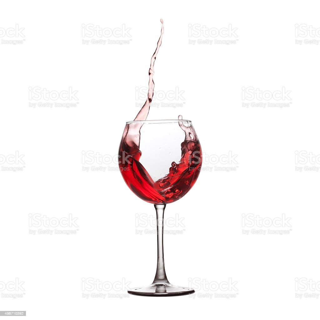 Red wine splash. splashing in crystal wineglass. white background stock photo