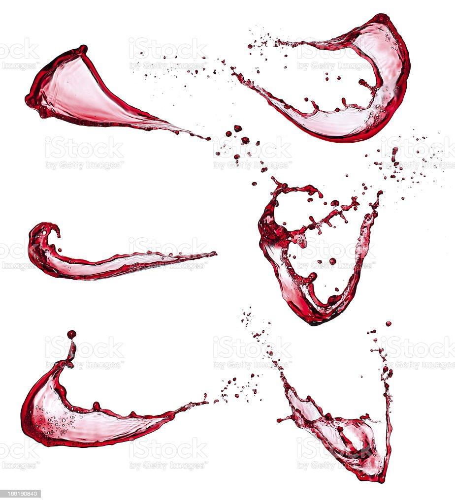 Red wine splashes against white background royalty-free stock photo