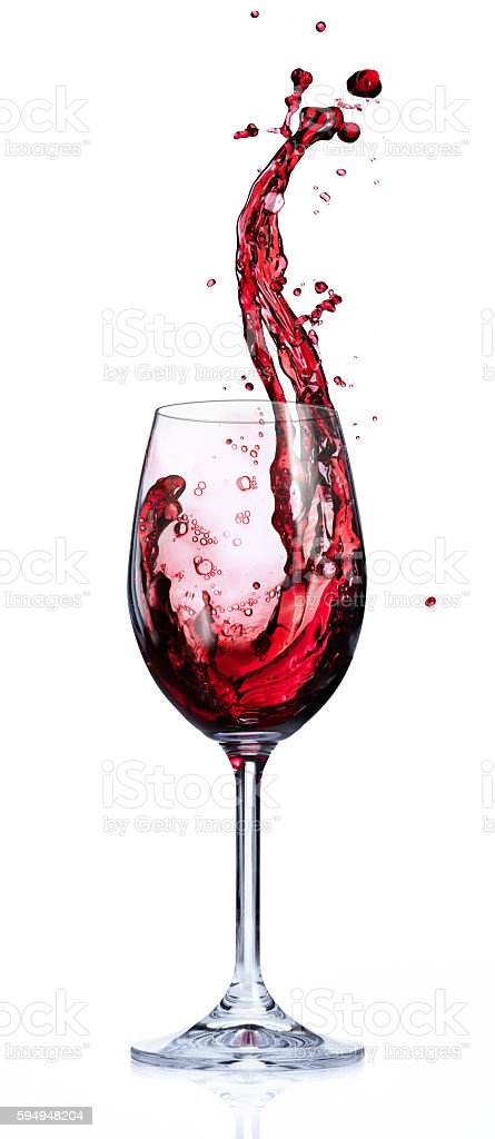 Red Wine Splashing In Glasses stock photo