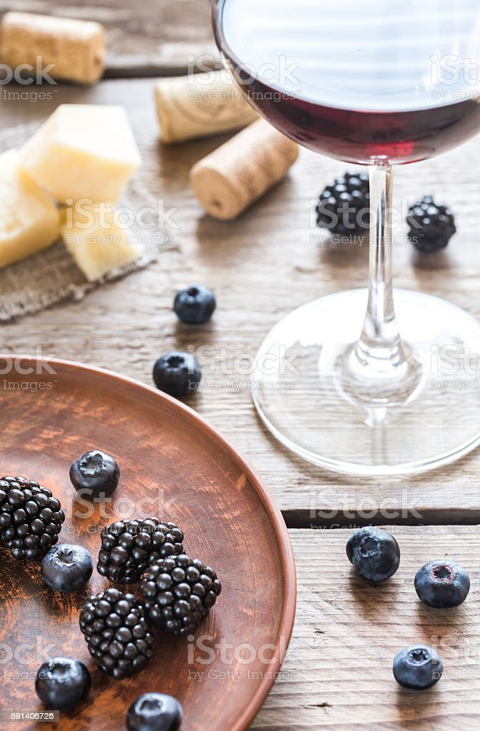 Red wine with berries stock photo