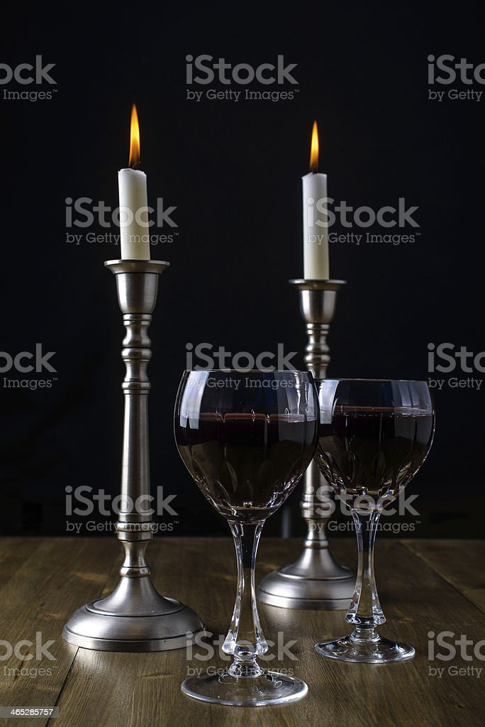 Red Wine with candles on wood table stock photo