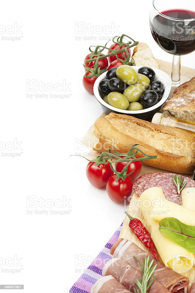 Red wine with cheese, prosciutto, bread, vegetables and spices stock photo