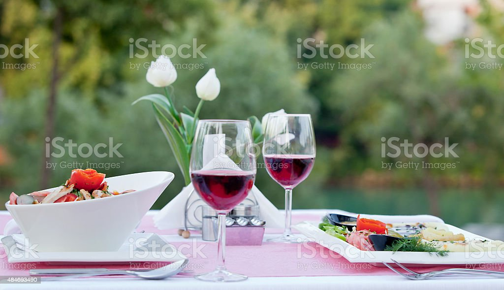Red wine with food stock photo