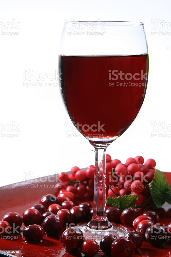 Red Wine with Glass Grapes and Cranberries stock photo
