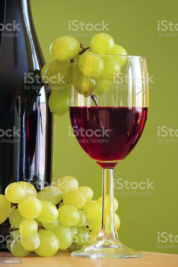 Red wine with grape bunch royalty-free stock photo