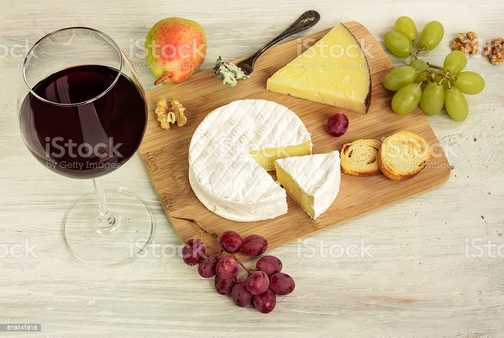 Red wine with many different types of cheeses and grapes stock photo