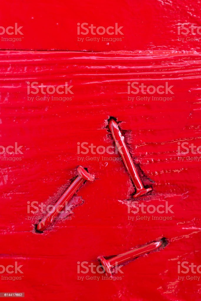 red wood blocks with nails. stock photo