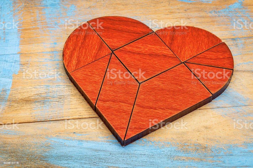 red wood heart tangram stock photo