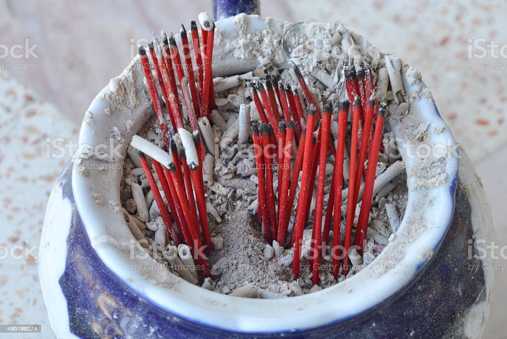 red wood incense stick on ash tray stock photo