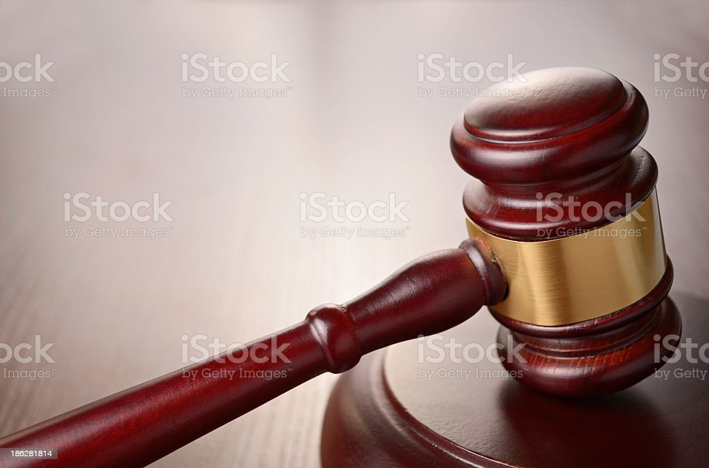 Red wooded gavel with gold band stock photo
