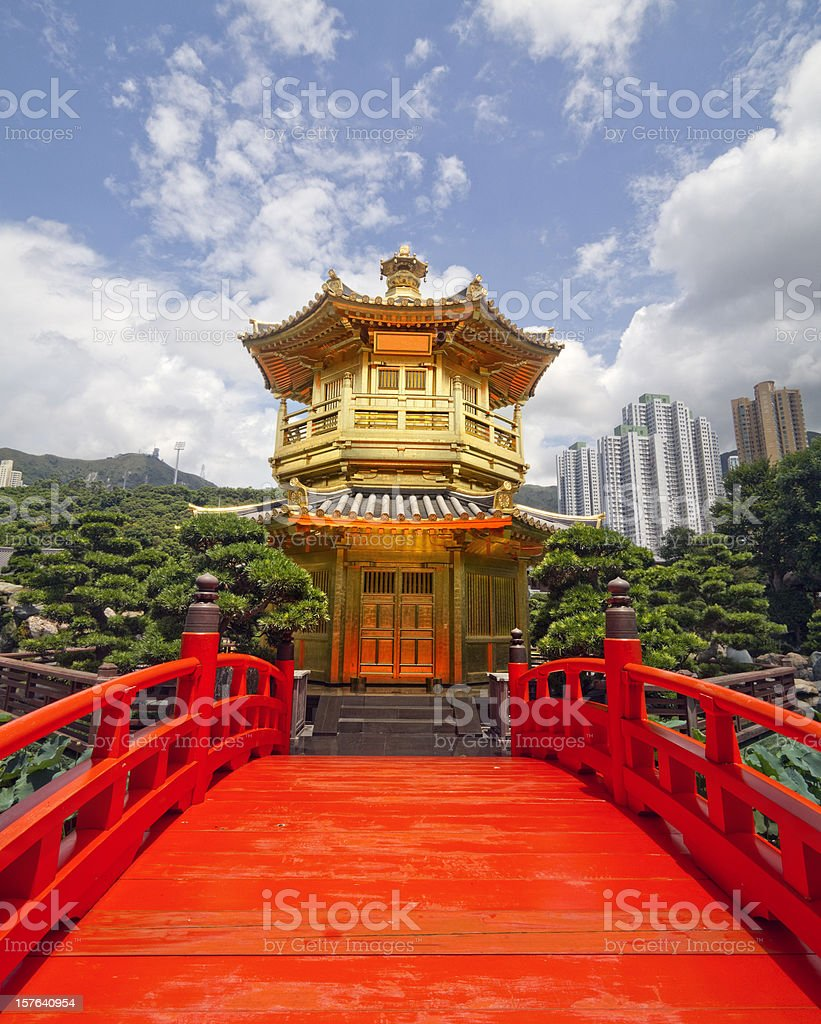 Red wooden Arch Bridge and Golden Pavilion stock photo