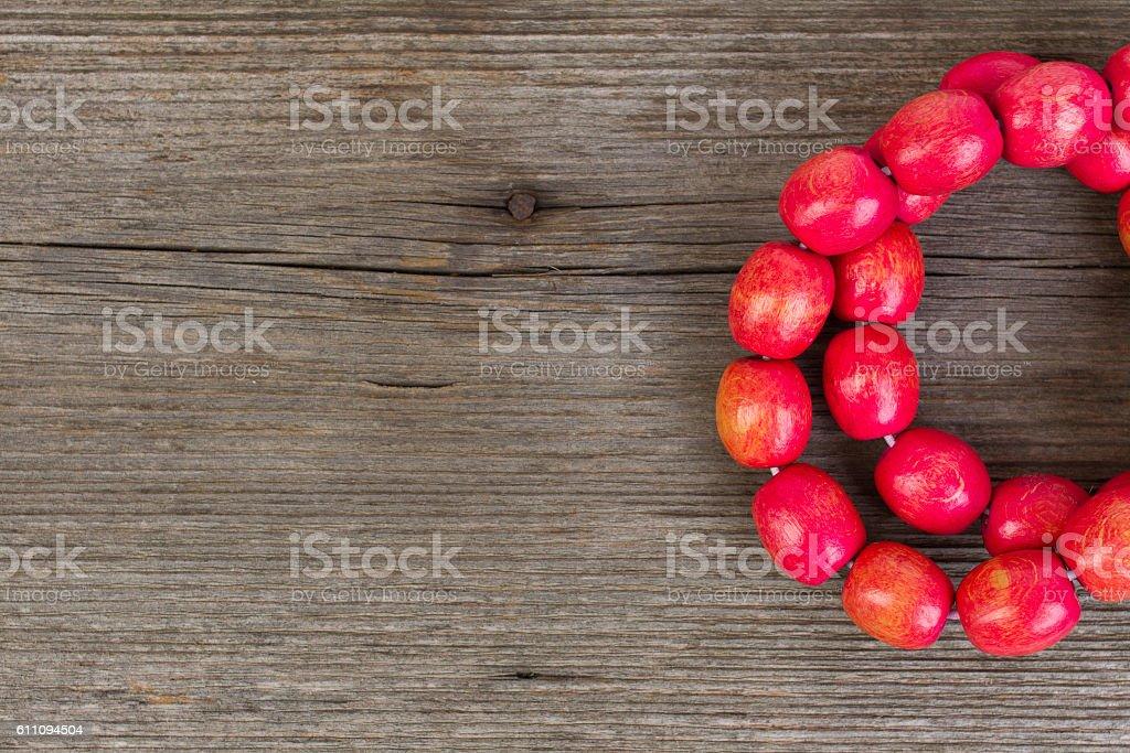 red wooden bracelet stock photo