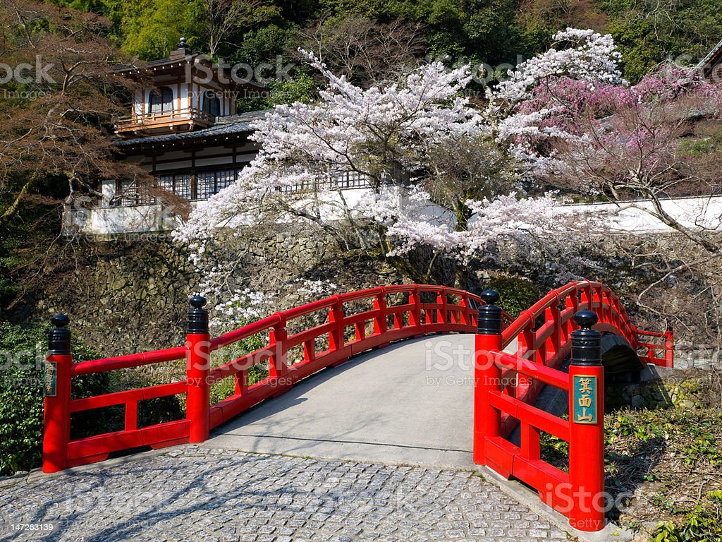 Red wooden bridge near Minoh waterfall royalty-free stock photo