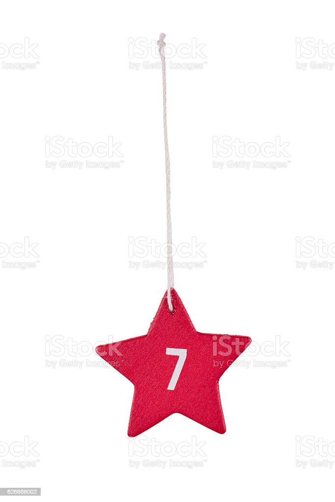 Red wooden Christmas star white number 7 string clipping path stock photo