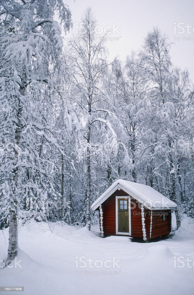 Red Wooden House in the Snow royalty-free stock photo