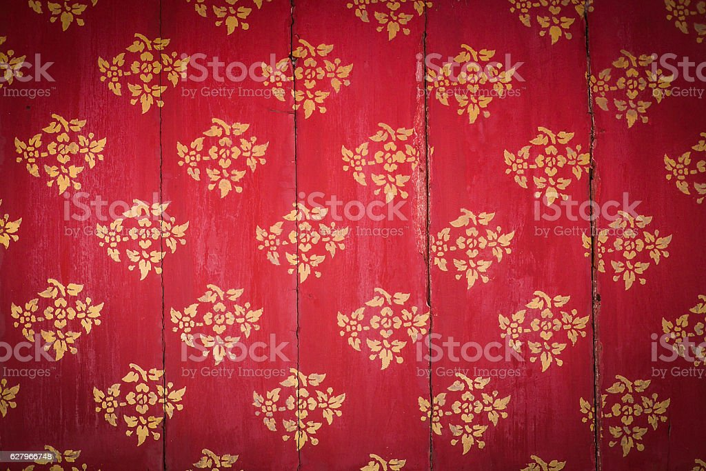 Red wooden Panel With Gold Stencils stock photo