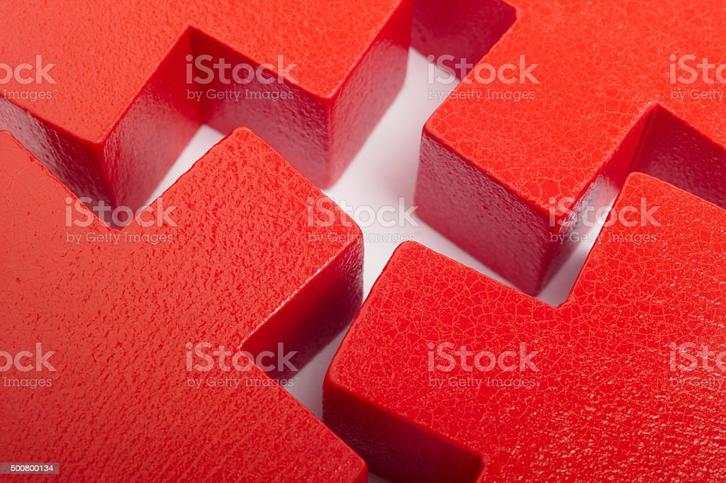 Red wooden toy pieces over a white background stock photo
