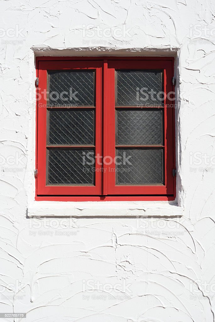 red wooden window stock photo