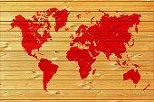 Red World map on wood