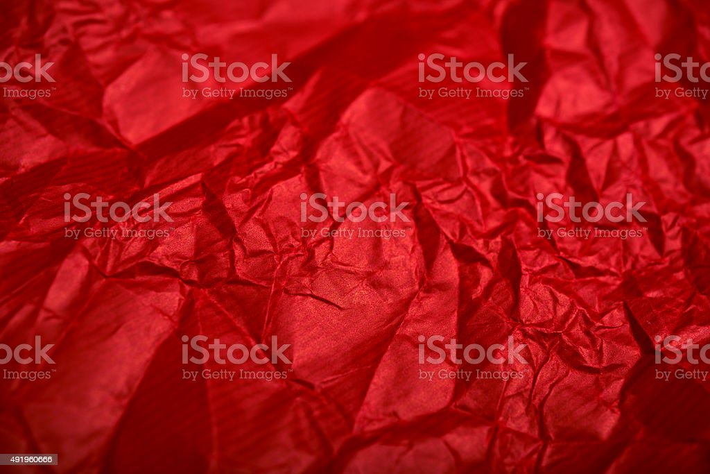 red wrapping and crumpled paper background stock photo