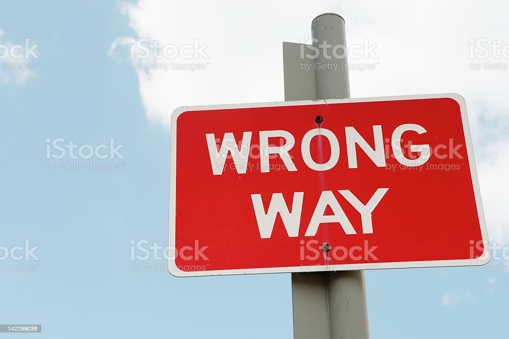 Red wrong way street sign on post stock photo
