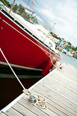Red yacht by dock