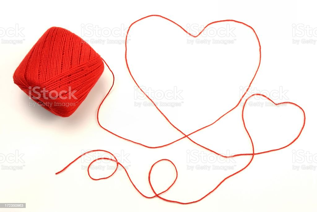 Red yarn or crochet string in the shape of hearts royalty-free stock photo