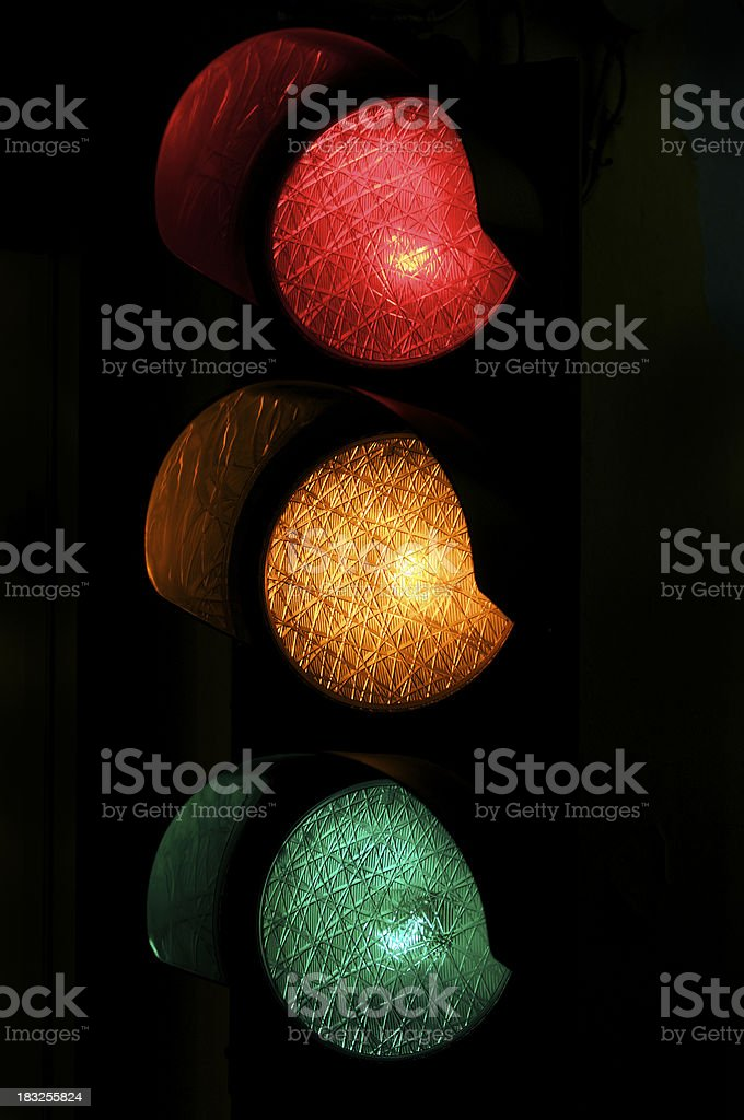 Red Yellow and Green Light Traffic Stoplight at Night royalty-free stock photo