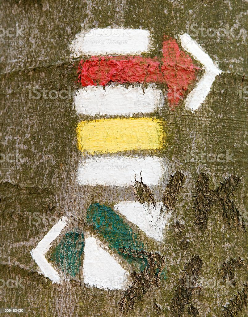 Red yellow and green tourist or hiking trail signs symbols stock photo