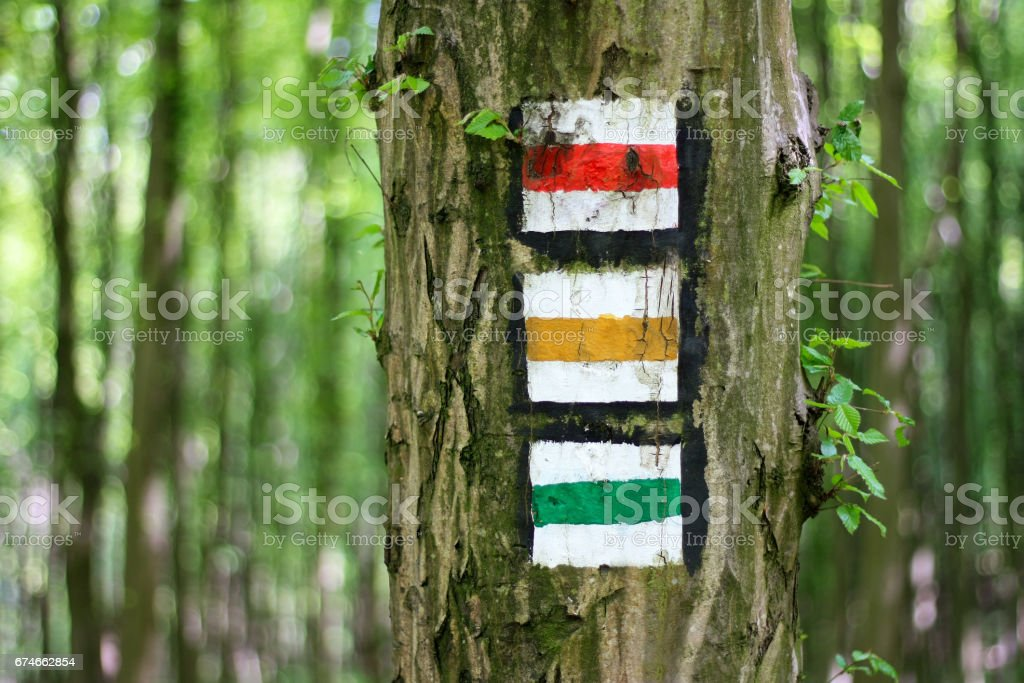 Red, yellow and green tourist sign stock photo