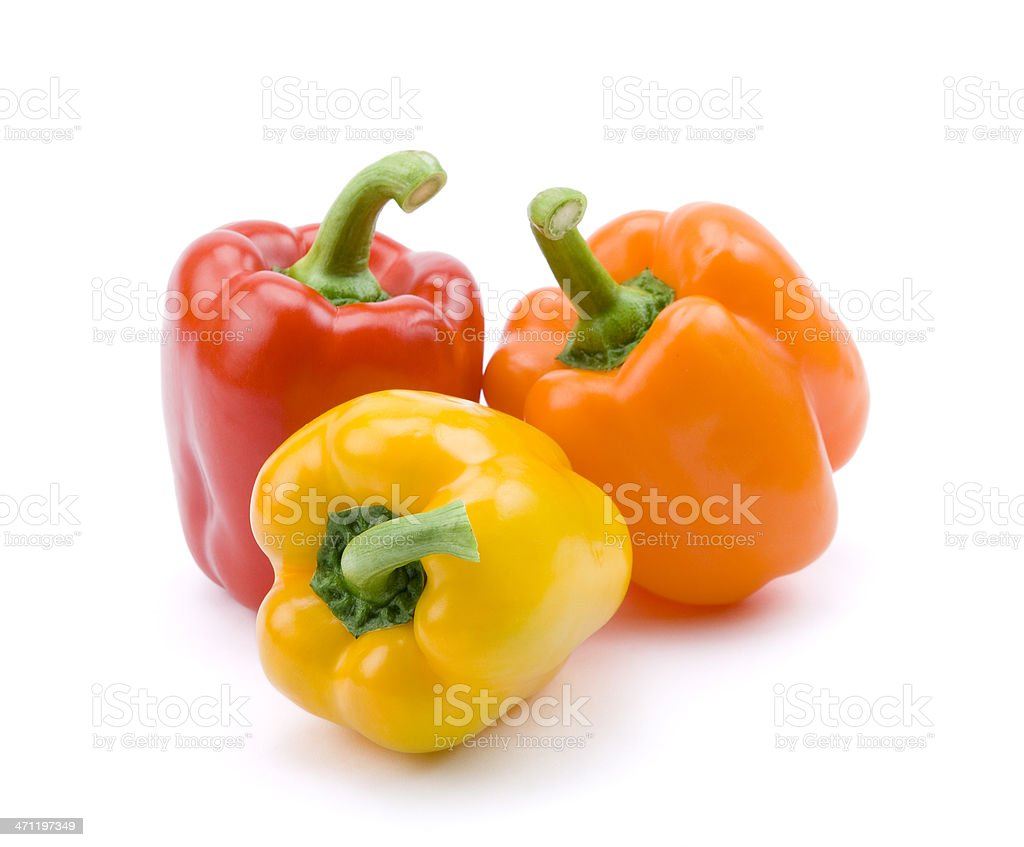 Red, yellow, and orange bell peppers stock photo