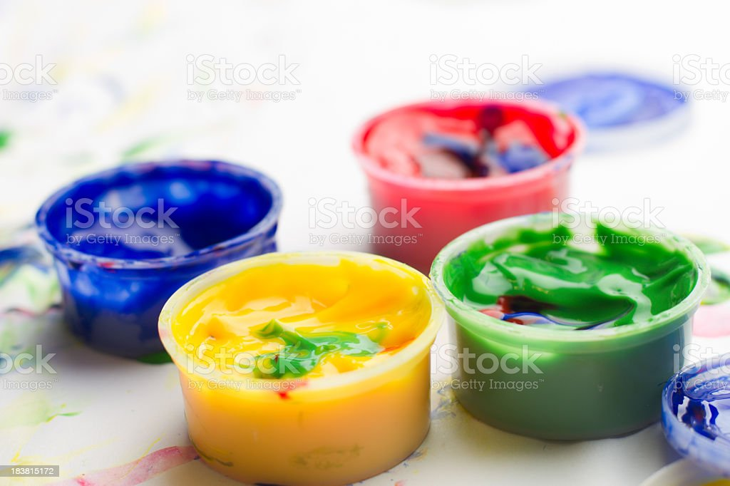 Red, Yellow, Blue, and Green Finger Paints stock photo