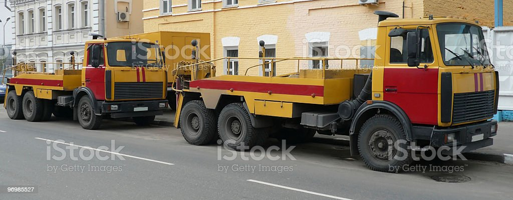 red yellow emergency truck on asphalt road royalty-free stock photo