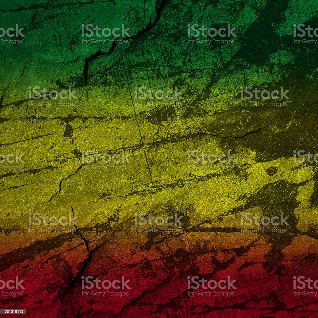 Red, yellow, green rasta flag on stone wall stock photo