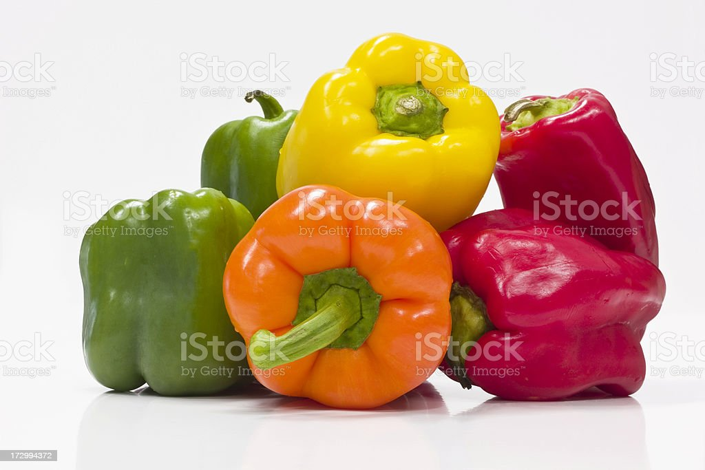 Red, Yellow, Orange, and Green Bell Peppers royalty-free stock photo
