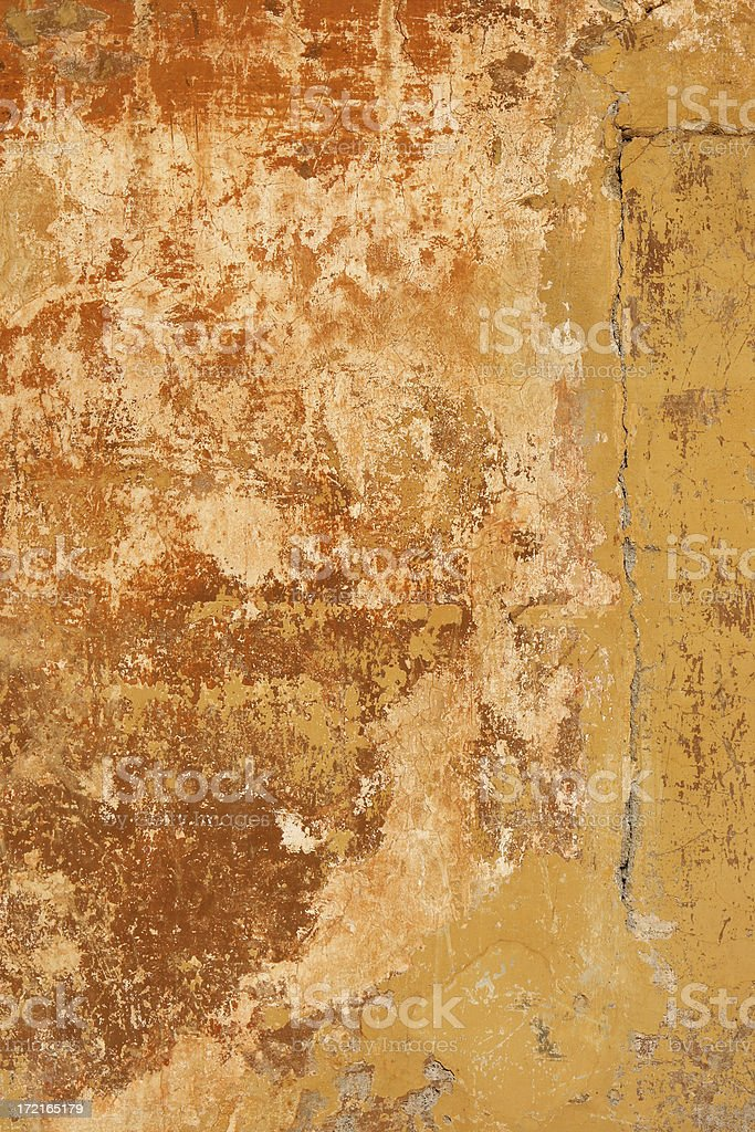 Red yellow Roman grunge wall texture with a crack royalty-free stock photo
