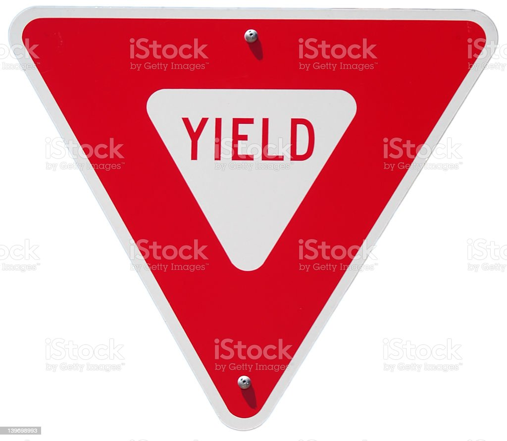 Red yield traffic sign against a white background stock photo