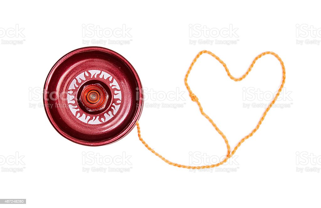 Red yoyo with heart-shaped twine stock photo