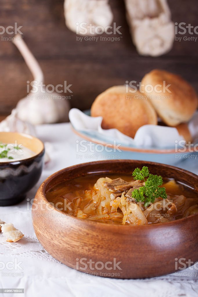 Redbeet soup with mushrooms and bread stock photo