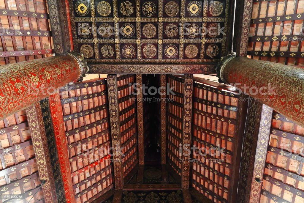 Red-black lacquered inner ceiling-gold stencilling-sim of WatXiengThong. Luang Prabang-Laos. 4116 stock photo