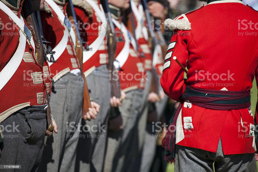 Redcoat Sergeant inspecting his men royalty-free stock photo