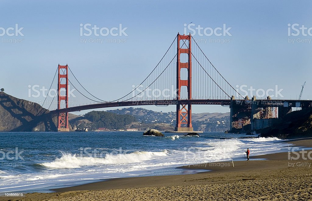 Red-colored Golden Gate Bridge from Barker Beach stock photo