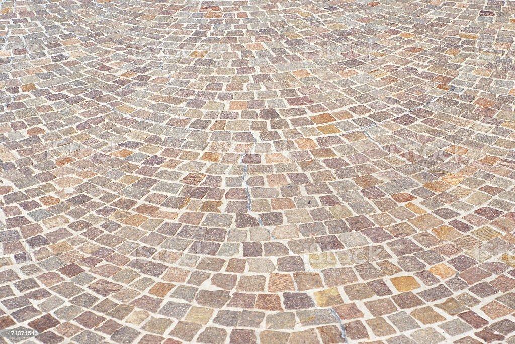Reddish cobblestone pavement royalty-free stock photo