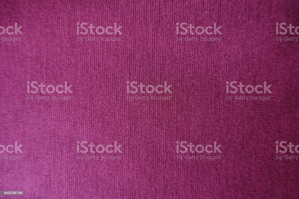 Reddish violet plain stockinet fabric from above stock photo