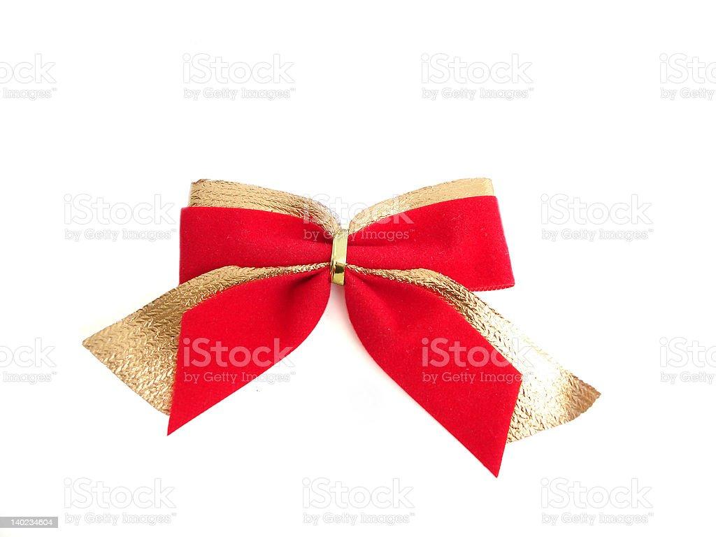 Vermelho laço dourado sobre um fundo branco foto de stock royalty-free