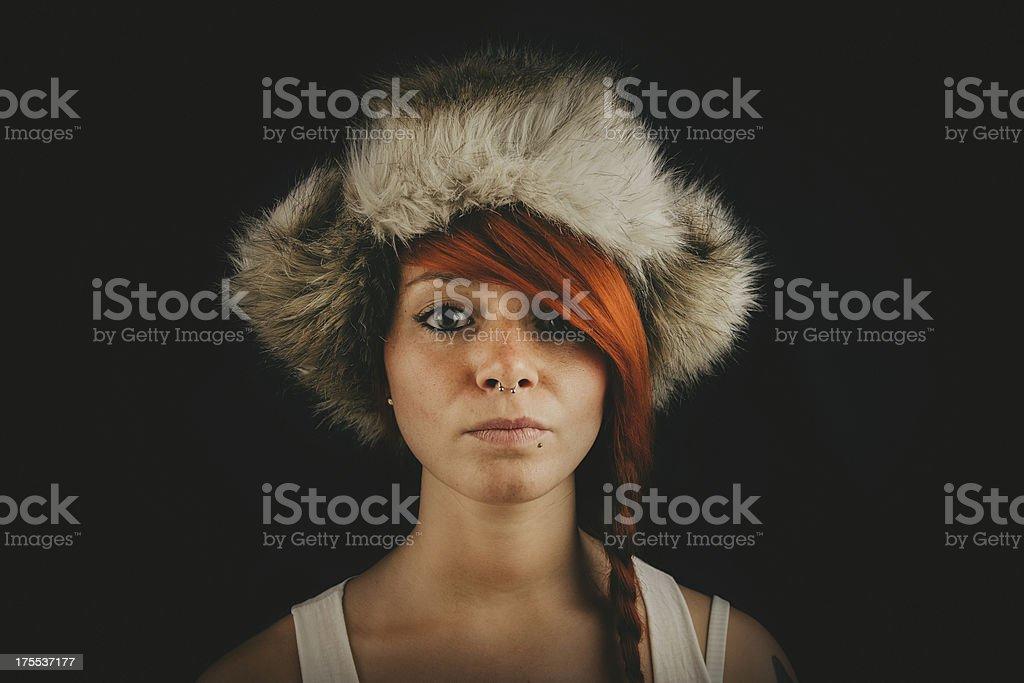 Redhair woman wearing fur hat royalty-free stock photo