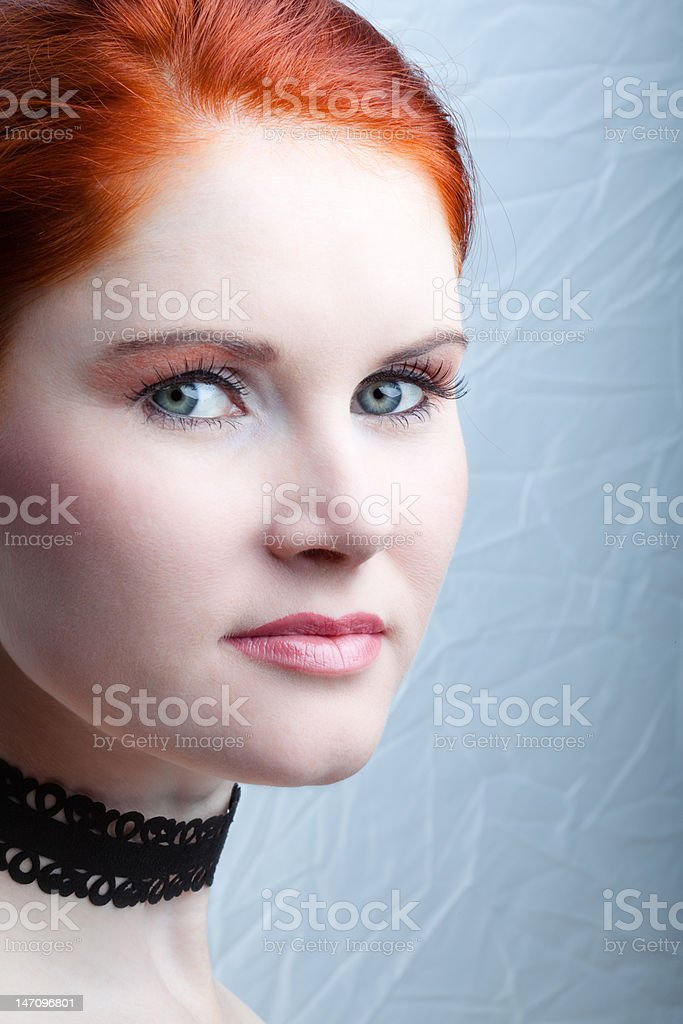 Red-haired beauty looking at camera royalty-free stock photo