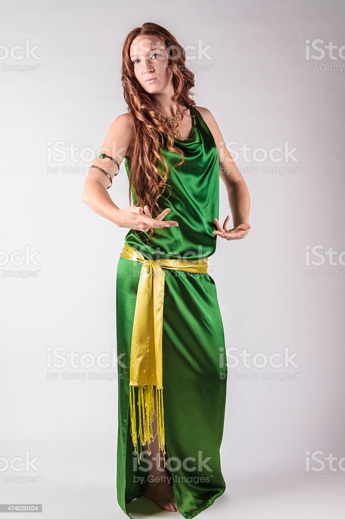 Red-haired Dancer Posing In a Green Dress stock photo