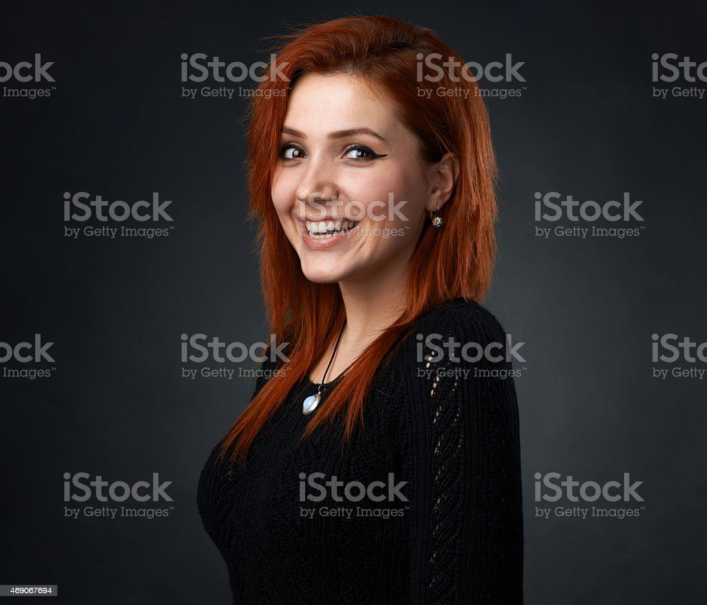 red-haired girl having fun smiling stock photo